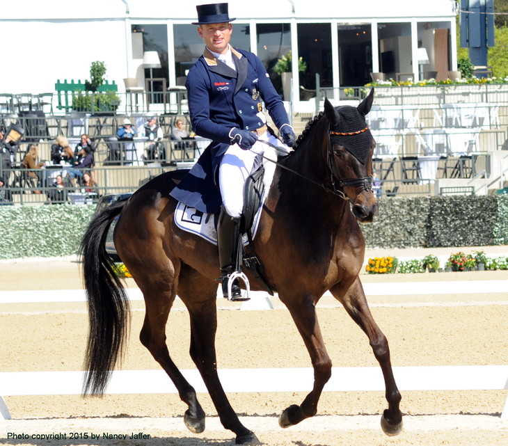 """Will Olympic eventing gold medalist Michael Jung someday be wearing a form-fitting shirt rather than """"museum clothes"""" for the dressage phase?"""
