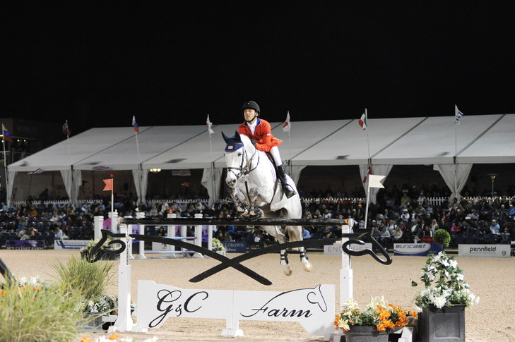 The Saturday Night Lights initiative at WEF introduces new people to the excitement of show jumping, bringing in crowds who fill the stands. (Photo by Nancy Jaffer)