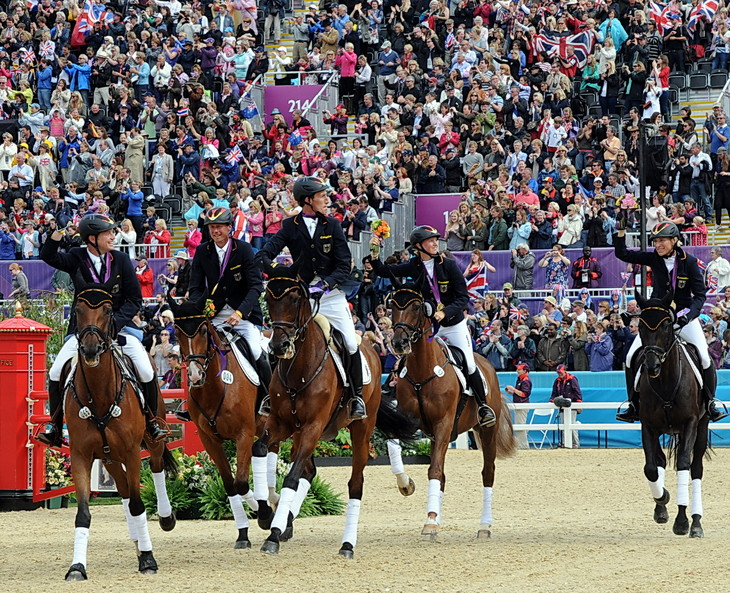 Olympic victory gallops, like this one by the German team at the 2012 London Games, will have two less participants if a controversial effort is passed to cut the number of riders on a squad. (Photo by Nancy Jaffer)